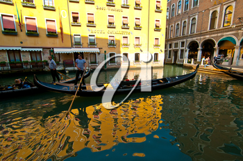 Royalty Free Photo of Gondolas Parked on a Canal in Venice