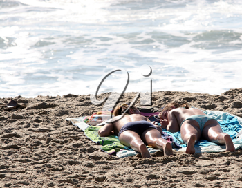Royalty Free Photo of Two Women Tanning on the Beach