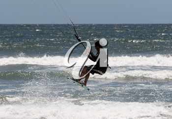 Royalty Free Photo of a Person Kite Surfing