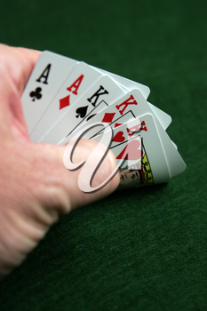 Royalty Free Photo of a Person Playing Poker