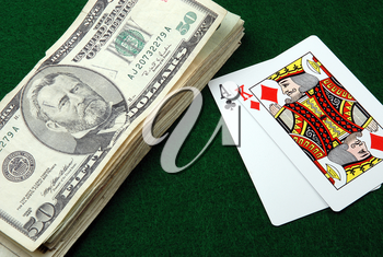 Royalty Free Photo of Playing Cards and Money