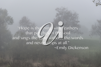 Royalty Free Photo of a Foggy Landscape With an Inspirational Quote