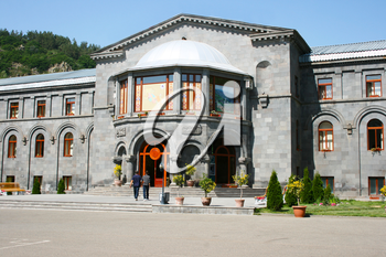 Royalty Free Photo of People by a Building in Jermuk, Armenia