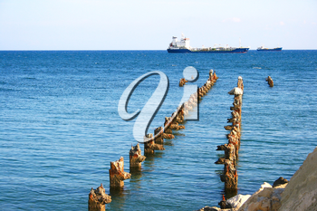 Royalty Free Photo of a Ship by an Old Pier