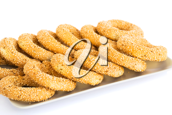 Round rusks with sesame seeads on tray.