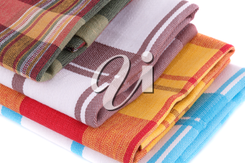 Stack of colorful kitchen towels on white background.
