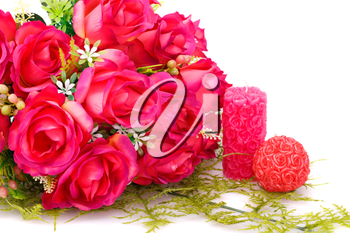 Candles, roses and glass heart  isolated on white background.