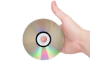 Single DVD(CD) disc hold in hand. Isolated over white