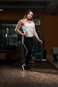Portrait Of A Young Sporty Woman In The Gym With Exercise Equipment