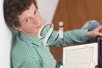 White Muslim Man Is Reading The Koran In The Mosque - Afro Lock Hair Curly