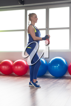 Fitness Woman Working With Kettle Bell In A Gym - Kettle-bell Exercise