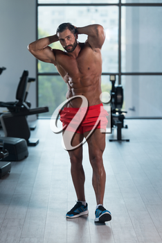 Portrait Of A Young Physically Fit Man Showing His Well Trained Body - Muscular Latin Athletic Bodybuilder Fitness Model Posing After Exercises