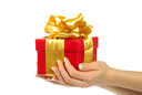 Royalty Free Photo of a Red Gift With a Gold Ribbon
