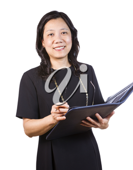 A portrait Vertical photo of a mature Asian woman wearing a dark dress while holding a folder, pen and glasses on a white background