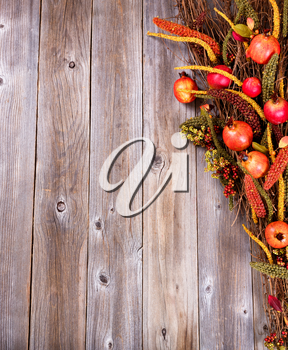 Overhead view of autumn decorations on rustic wooden boards.