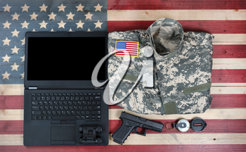 United States military equipment with modern technology on rustic wooden flag