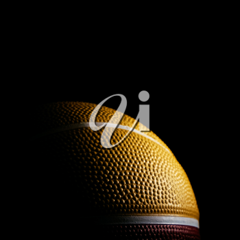 Macro of a basketball isolated on black