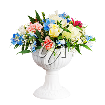 Bouquet from flowers arrangement centerpiece in vase isolated on white background. Closeup.