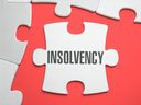 Insolvency - Text on Puzzle on the Place of Missing Pieces. Scarlett Background. Close-up. 3d Illustration. 3D Render.