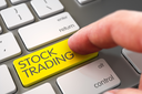 Finger Pushing Stock Trading Keypad on Computer Keyboard. Computer User Presses Stock Trading Yellow Keypad. Selective Focus on the Stock Trading Key. 3D Illustration.