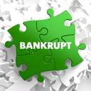 Bankrupt on Green Puzzle on White Background.