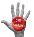Stop Parkinson's - Red Sign Painted on Open Hand Raised, Isolated on White Background.