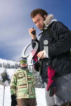 Two backcountry freeriders - the man and the young woman, - are standing with the radio and waiting for the answer.