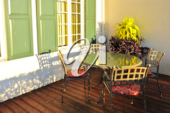 Patio chairs and tables on wooden patio deck