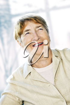 Senior woman laughing and smiling with abstract background