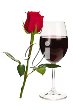Romantic glass of red wine with long stemmed rose