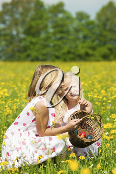Children on an Easter Egg hunt on a meadow in spring still looking clueless