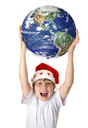 A joyous boy holding our beautiful planet earth above his head.  concept.