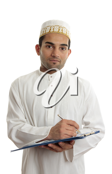 Arab mixed race business man wearing traditional middle eastern attire and topi gold embroidered hat.  He is holding a clipboard folder and writing.  White background.