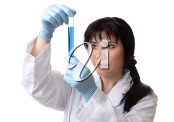 A scientist or other laboratory worker holds a test tube in gloved hands.