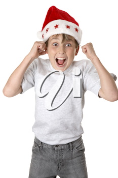 A child wearing a red santa hat jumps with glee and anticiapation.