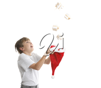 Boy looking up is catching falling Christmas presents