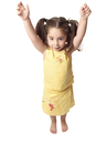Pretty little toddler girl with both arms raised above her head.  She is smiling and has hair in ponytails,