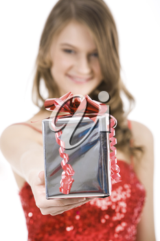 Close-up of Christmas present in female�s hand being given by smart girl