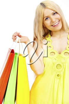 Happy female with bags looking at camera with smile