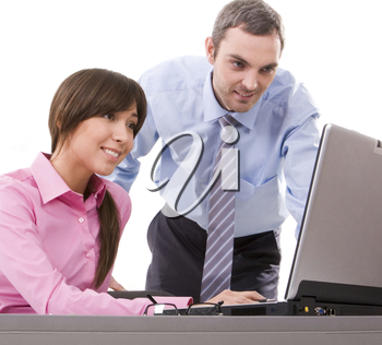 Image of business partners looking at laptop display at work