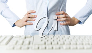Close-up of female keeping her hands on waist before computer keyboard