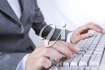 Photo of secretary hands typing a document on the keyboard