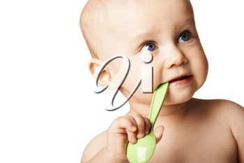 Adorable baby with spoon in mouth looking aside over white background