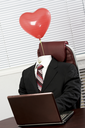 Image of elegant suit without someone in it and with heartshaped balloon above