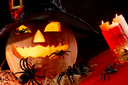Image of Halloween pumpkin in hat with spiders on it