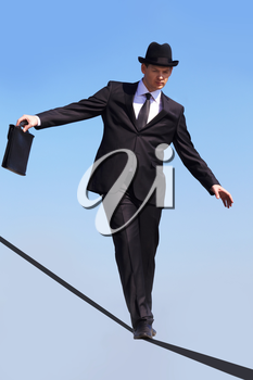 Photo of skilled businessman walking down ribbon or rope with blue sky at background