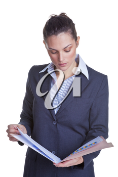 Businesswoman reading some documents in a file, isolated on a white background.