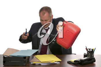 Businessman about to set fire to a pile of documents.