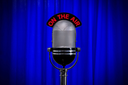 Retro microphone on stage against a blue curtain with spotlight effect