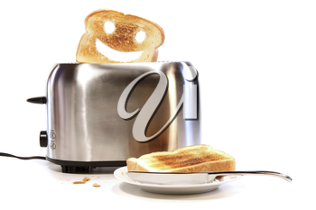 Royalty Free Photo of Toast With a Happy Face in a Toaster